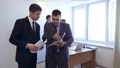 Businessman with his colleague stands with documents and discuss it. 50662381