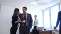 Businessman with female colleague flirts in office. 50667045