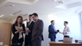 Businessmen with female colleague stands with documents in office. 50667054