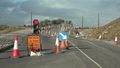 Traffic light counting down at road construction site 50719472