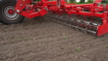 close-up, tractor cultivator cultivates, digs the soil. tractor plows the field. automated tiller 50732882