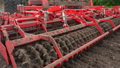 close-up, tractor cultivator cultivates, digs the soil. tractor plows the field. automated tiller 50732917