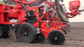 close-up, tractor cultivator cultivates, digs the soil. tractor plows the field. automated tiller 50733063