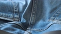 Blue denim jeans. Macro dolly shot. Selective soft 50762795