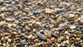 Pebbles on the sea coast, washed by water in slow motion, close-up 50866831