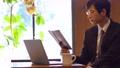 カフェ ビジネスマン 人物の動画 50957499