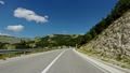 Road trip through hilly terrain - POV view. 51333757