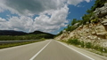 Camera moving fast over asphalt road on cloudy day in green nature of Montenegro. 51333758