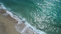 Beautiful turquoise sea, waves and sandy beach, aerial view. Slow motion. 51339775