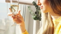 Young girl drinks champagne sitting on a bar stool near window 51352915