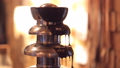 chocolate fountain. the man prepares the fountain to serve. close up 51596112