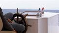 Captain at the Steering Wheel of a pleasure boat. Captain controls the sea yacht 51622356
