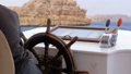 Captain at the Steering Wheel of a pleasure boat. Captain controls the sea yacht 51622521