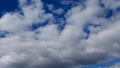 Time lapse of cumulus clouds against a blue sky. 51901823