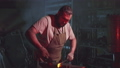 A blacksmith is working in a blacksmith shop 52975725
