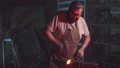 Strong bearded blacksmith is working in his forge 52975726