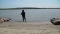 Senior Man with a Fishing Rod on a River Bank 52977394
