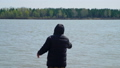 Senior Man Casting a Fishing Rod in a River 52977404