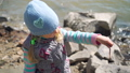 Young Girl Examining an Earthworm on Fishing Trip 52977425