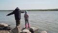 Young Girl Fishing with her Grandpa 52978025