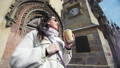 Smiling travel woman admiring architecture drinking coffee paper cup medium close-up 52983699