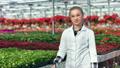 Woman agricultural engineer posing in greenhouse enjoying break having positive emotion 52984135