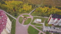 Aerial top view of the modern houses in the countryside near the park with yellow trees, nature in 53188463