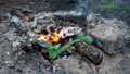 Campfire in wood. Burning garbage on an open fire after meal. Care for the environment. 53201397