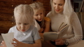 Woman reading books to her two kids girl 53204449