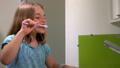 Girl cleans his teeth 53208930
