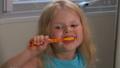 Girl cleans his teeth 53208938