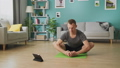 Young man following the instructions on the tablet and do the asana 53234188