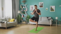Young man doing yoga in the morning in his living room 53234683