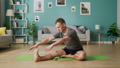 Medium shot of young man doing yoga in the morning in his living room 53234686