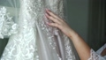Bride touching her dress 53238999