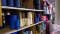 Spools of thread on the shelves video 53250460