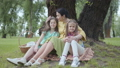 Family, leisure and people concept. Happy grandmother and granddaughters having picnic at summer 53307905