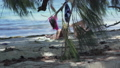 Seychelles. Praslin Island. Two girlfriends lying in the shade of palm trees read books on the 53355590