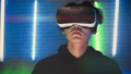 Guy watches a 360 video in virtual reality glasses 53359207