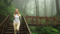 Blonde Caucasian Female Foreign Tourist Visit Alishan Scenic Area Walking Through Forest with Mist 53619192