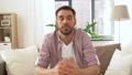 male blogger videoblogging at home 53626013