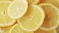 Pile of yellow lemon slices, close shot. Rotative 53740309