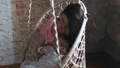Mom with a child in a hanging chair 53793668