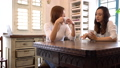 カフェで珈琲を飲みながら話している2人の若い日本人女性 53794210