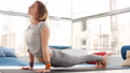 Portrait of young beautiful young woman doing yoga or pilates exercise. 53900931