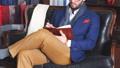 Portrait of attractive man in dark coat and trendy suit indoors tailors 53925183