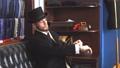 Portrait of attractive man in dark coat and trendy suit indoors tailors. 53925185