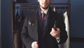 Portrait of attractive man in dark coat and trendy suit indoors tailors 53925196