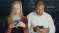 Multi-ethnic multiracial busy couple using smarkphone at cafe or coffee shop. 54032636