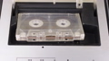 person inserts an audio cassette into a tape  54056628